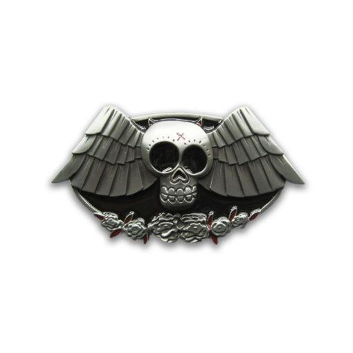 Boucle de ceinture en métal représentant une chauve souris avec une tête de mort