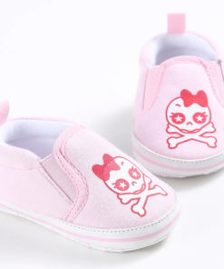 Chaussures pour bébé de couleur rose avec tête de mort